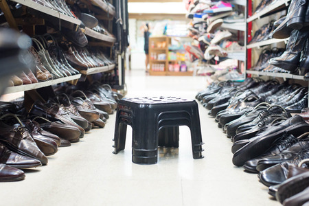 second floor: Shop of second hand shoes with chair for try to wear.