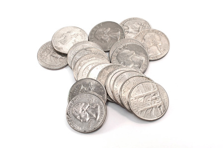 Pile of American coins (Quarter ) on a white background.