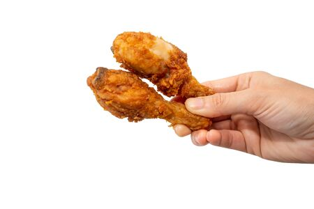 Hand hold fried chicken drumsticks on white background.