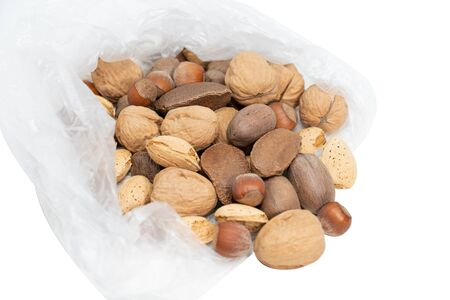 Mixed nuts with shell in plastic bag.