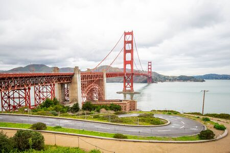 Landscape view of the Golden Gate Bridge on a beautiful cloudy day.