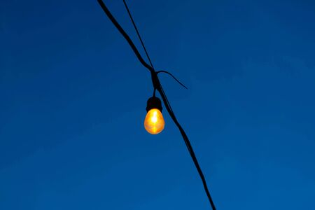 Light bulbs on string wire.