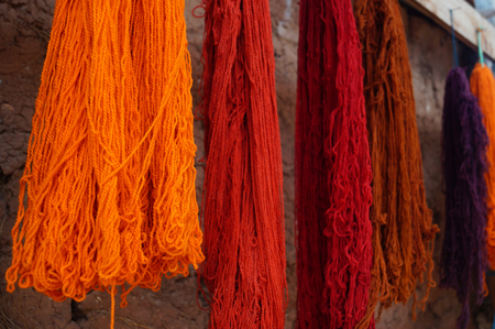 used clothes: Peruvian wool of different colors used for the manufacture typical clothes of the Inca culture Stock Photo