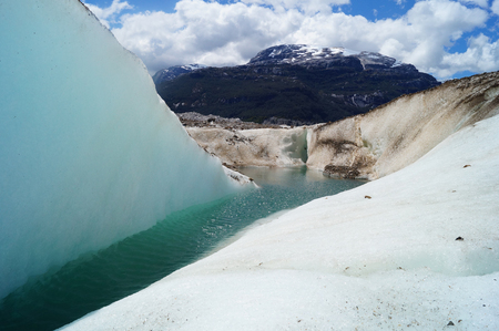 glaciar: Water in a glaciar with mountains on the background  in Patagonia