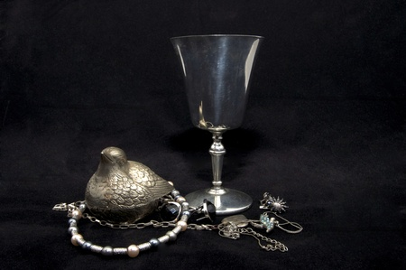 argent: old silver and precious silver cup product on a black background