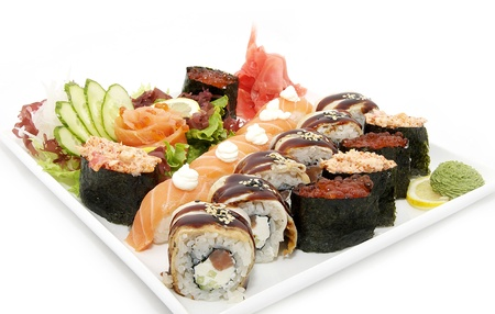 large plate of sushi with vegetable photo