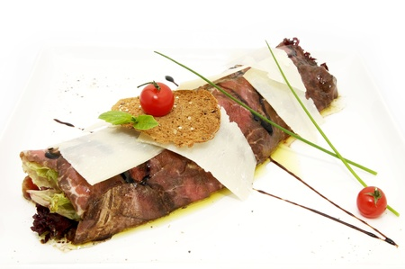 Carpaccio in the form of roll on a white plate Stock Photo - 12719719