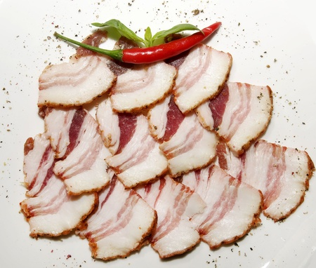 decomposition: bacon with pepper decomposition beautifully on a plate