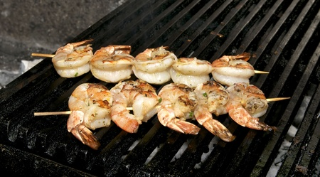 two skewers of shrimp prepared on the grill photo