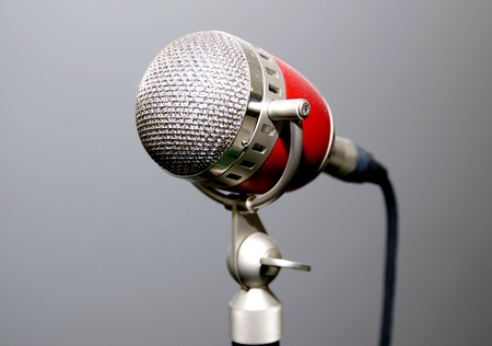 old microphone for singer with a gray background photo