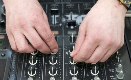 regulators: hands near the disc jockey music equipment