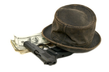 dollars and a gun and a hat on a white background photo
