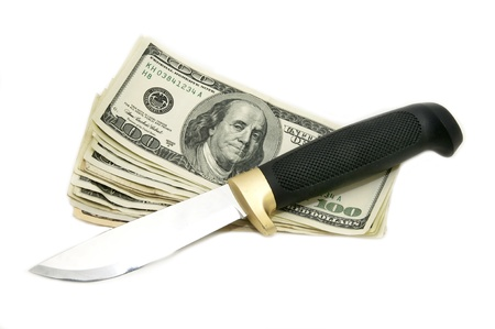 stickup: dollars and a knife on a white background Stock Photo