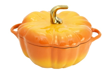 a large saucepan in a pumpkin on a white background photo