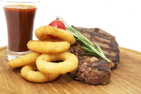 Grilled steak and onion rings on a white background photo