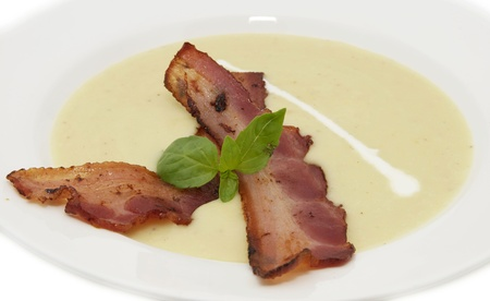 pea soup with bacon on a white plate Stock Photo - 13121647