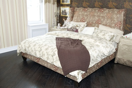 a large comfortable bedroom in the style of the nineteenth century photo