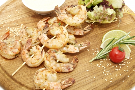 grilled shrimp with a salad on a wooden plate Stock Photo - 13635785