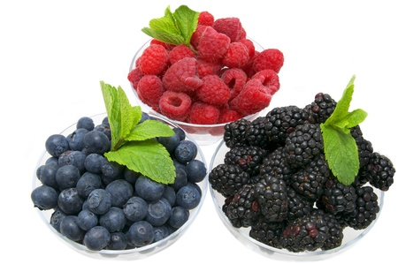blueberries raspberries and blackberries on a white background in the restaurant photo