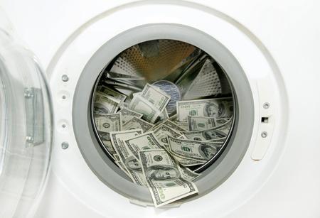 washing machine and wash paper dollars dollars Stock Photo