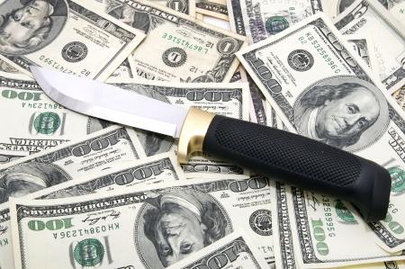 stickup: Finnish knife lying on the U.S. Dollar