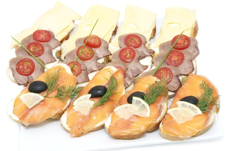 salmon sandwiches with cheese and rice on a white plate photo