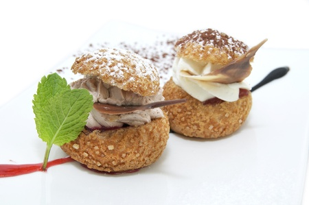 profiteroles with vanilla ice cream decorated with chocolate mint photo