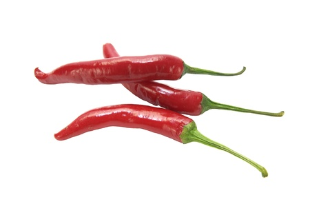 pods of red chili peppers on white background photo