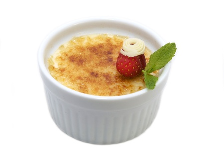 portion of the cream brulee on a white background photo