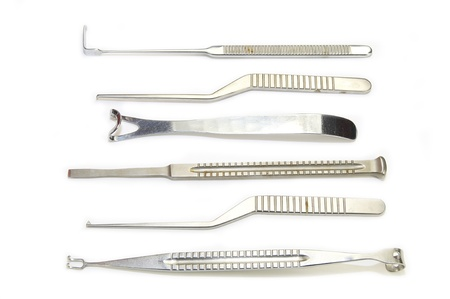 steel surgical instruments on a white background photo