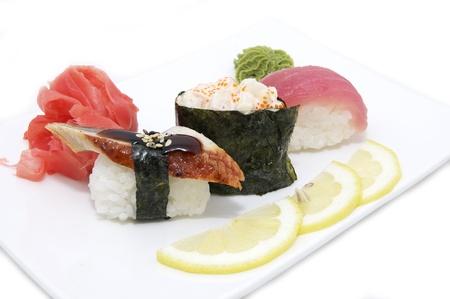 serving traditional Japanese sushi on white background photo