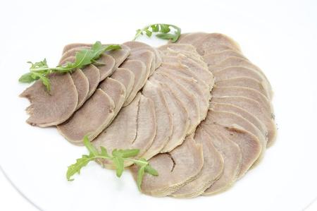 a dish of beef tongue photo