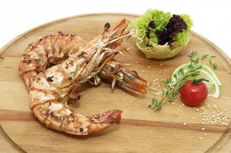 hoisin: Grilled Shrimp with Orange on a wooden plate