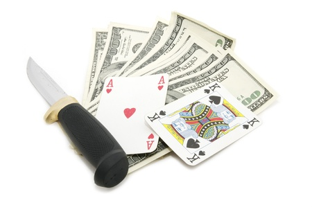 dollars and a knife on a white background
