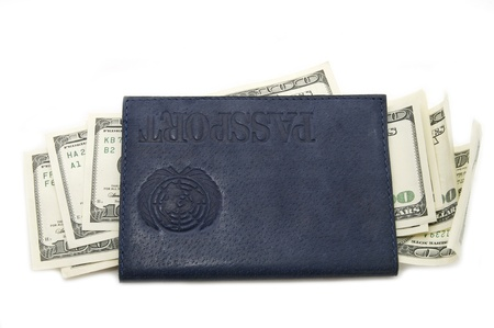 dollars and a passport on white background photo