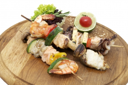 seafood platter: skewers of seafood on a wooden platter in a restaurant