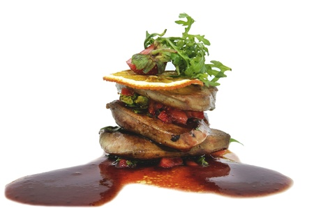 foie gras: Roast goose liver is decorated with greens and strawberries