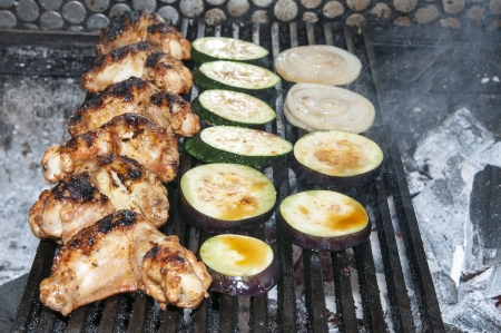 cooking chicken wings on a grill in the restaurant Stock Photo - 14811785