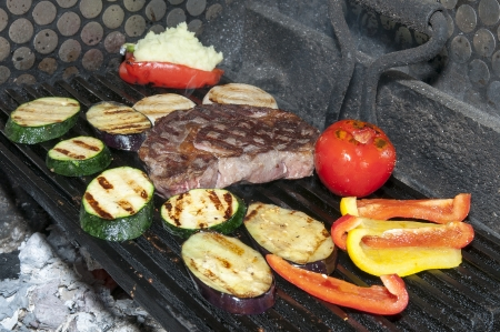 Grilled vegetables are cooking with fire photo