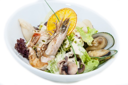 salad with seafood in a restaurant on a white background photo