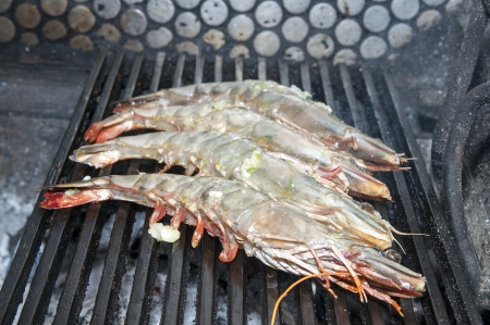 cooking shrimp on the grill in the restaurant photo