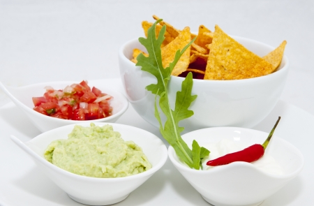 Mexican food dishes at the restaurant on a white background photo