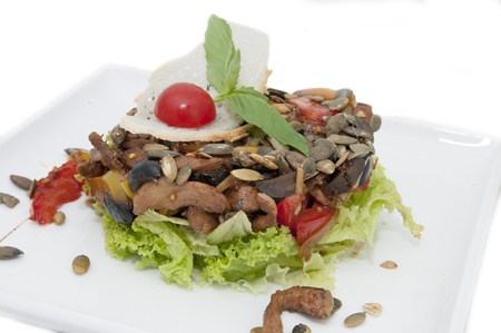 vegetable salad in a restaurant on a white plate photo