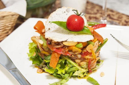 Thai vegetable salad on white dish at restaurant photo