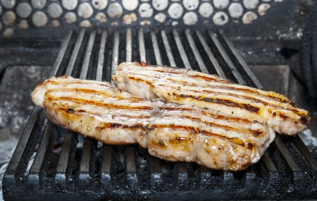 cooking catfish meat on the grill photo