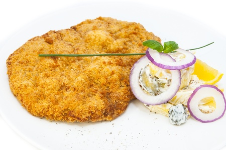 Schnitzel vegetable salad at restaurant photo