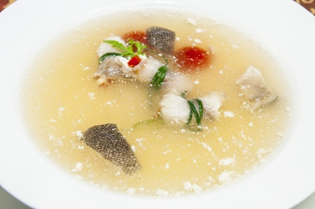 fish soup on the table in a restaurant photo