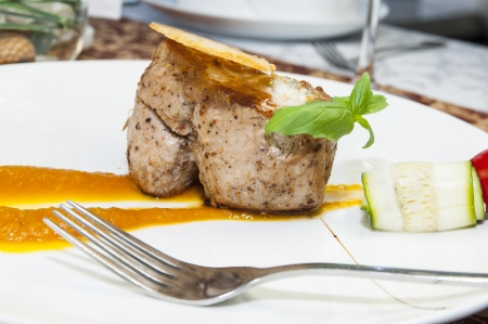 baked meat with sauce on a table in a restaurant Stock Photo - 15434950