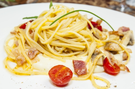 spaghetti with cheese and meat on a white plate photo