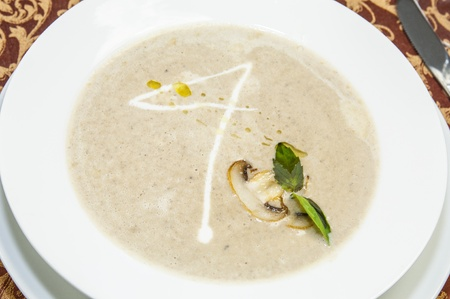 mushroom soup sauce on a table in a restaurant photo